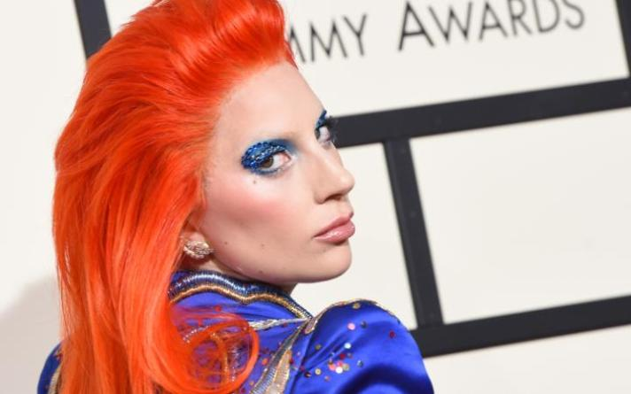 89739856_TOPSHOT - Singer Lady Gaga arrives on the red carpet during the 58th Annual Grammy Musi-large